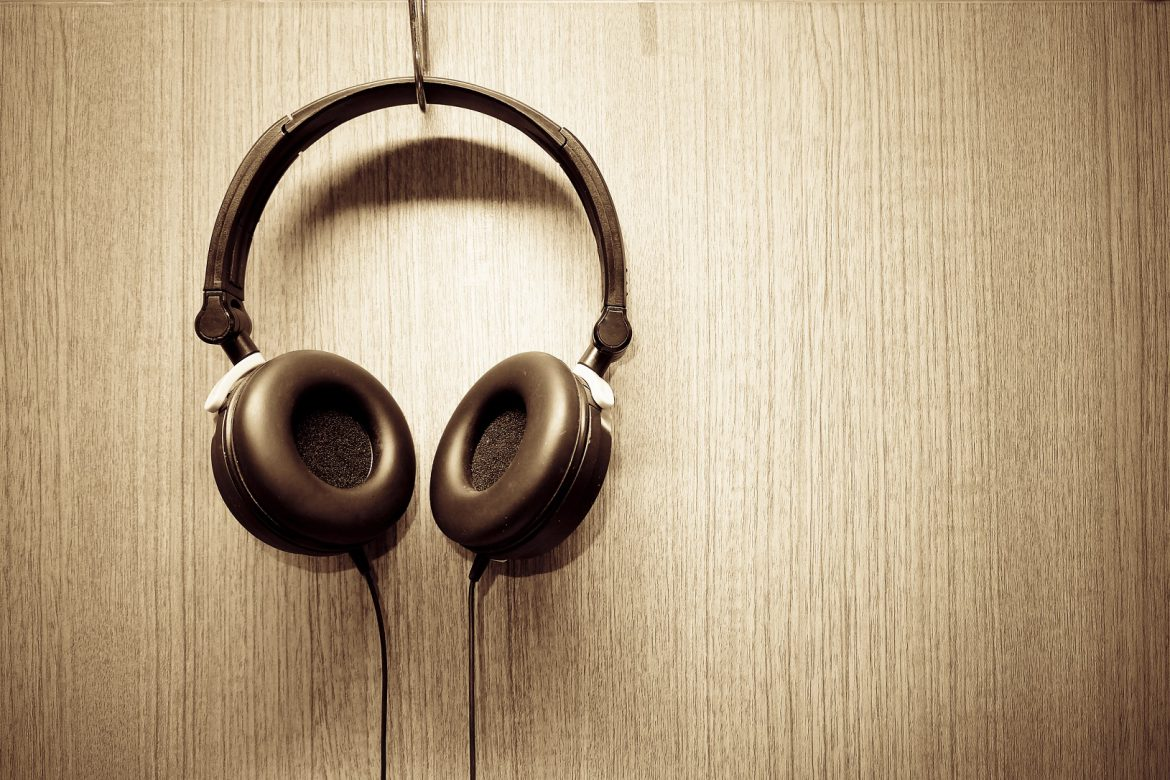 Headphone hanging on wooden wall ,Sepia color