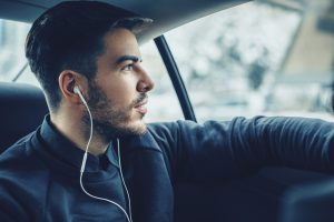 Young man listening music in the car